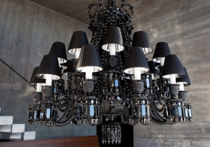lighting: ZÉNITH CHANDELIER 24 LIGHTS MAINTAINING THE CHANDELIER'S ORIGINAL STRUCTURE AND ORNAMENTATION, STARCK ADDS BLACK SHADES LINED WITH ALUMINUM REFLECTORS TO MAGNIFY THE EFFECT OF LIGHT ON THE BLACK CRYSTAL. BACCARAT'S SIGNATURE RED:  SIZE: DIA.: 108CM, H 117 | ARCHONTIKIS-BACCARAT