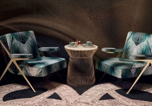 furniture: FIJI ARMCHAIR WITH ITS IRRESISTIBLE FIFTIES CHARM REVISITED IN A CONTEMPORARY KEY, THE FIJI ARMCHAIR IS CHARACTERIZED BY THE DYNAMISM AND ESSENTIALITY OF THE LINES. PRESENTED THIS YEAR WITH THE NEW SILK UPHOLSTERY WITH BANANA LEAF PRINT, THE FIJI ARMCHAIR | ARCHONTIKIS - ROBERTO CAVALLI