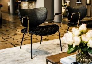 furniture: CALIDA LOUNGE: ARMCHAIR WITH BASE IN MATT BLACK VARNISHED METAL ROD. SEAT, BACK IN CURVED BEECH WOOD, PADDING IN HIGH-RESILIENCE EXPANDED POLYURETHANE. METAL GLIDES AND ARMREST (OPTIONAL) IN POLISHED GOLD FINISHING. | ARCHONTIKIS - BLACKTIE