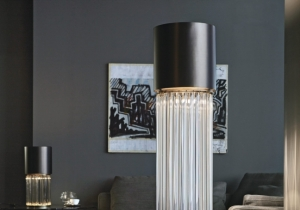 lighting: CHIC FLOOR AND TABLE LAMP WITH DIFFUSED LIGHT. DARK BRONZE STRIPED STRUCTURE AND CRYSTAL, AMBER OR SMOKE GREY MURANO BLOWN GLASS TRIHEDRONS. | ARCHONTIKIS - VENICEM