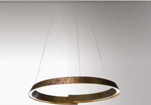 lighting: SWIRL IS A SUSPENSION LAMP MADE OF A THIN STRIP OF METAL IN SPIRAL FORM THAT GENERATES AN UPWARD MOVEMENT. | ARCHONTIKIS - LAURA MERONI