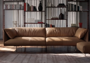 furniture: JOHN-JOHN JEAN-MARIE MASSAUD, A COLLECTION OF SOFAS THAT STAND OUT FOR THEIR ENVELOPING, SELF-ASSURED ELEGANCE.THE CUSHIONS, PADDED WITH SOFT GOOSE DOWN. PELLE FRAU® LEATHER. ALUMINIUM FEET WITH RUTHENIUM FINISH AND PROTECTIVE TRANSPARENT PLASTIC CAPS. | POLTRONA FRAU
