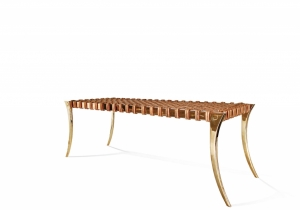 furniture: KLISMOS BENCH - BRASS.THIS BRUSHED-POLISHED SOLID CAST-BRASS BENCH IS ANOTHER EXAMPLE OF THE UTMOST LEVEL OF IMAGINATION, CREATING AN EXCEPTIONALLY UNIQUE PIECE.THIS BENCH HAS A HAS A HAND-WOVEN LEATHER STRAPPED SEAT. SIZE: W 127 X D 43.2 X H 43.2 CM