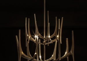 "lighting: TUSK  DESIGN BY BAYLAR ATELIER  POLISHED STAINLESS STEEL  SIZE SHOWN APPROX. 36"" DIA X 28\""H 